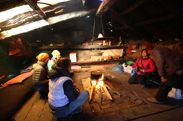 Hanging out with a local Tibetan in his hut. Shika Snow mountain. Photo: Rick Wicklund