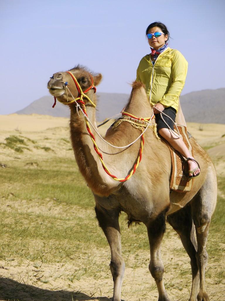Szu-ting Yi riding camel Mongol Els Mongolia